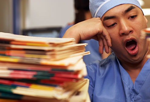 getty_rm_photo_of_nurse_yawning_over_paperwork
