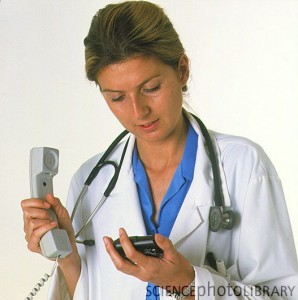 M5410139-Doctor_holding_a_telephone_while_looking_at_pager-SPL-298x300